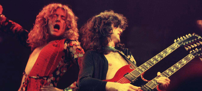 Robert Plant and Jimmy Page of Led Zeppelin Led Zeppelin in Concert at Chicago Stadium - 1-20-1975 Chicago Stadium Chicago, Illinois USA January 20, 1975 Photo by Laurance Ratner/WireImage.com  To license this image (317516), contact WireImage.com