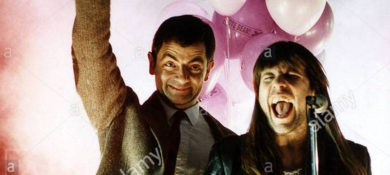 Rowan Atkinson Comedian and Actor singing with Bruce Dickinson of the Pop Group Iron Maiden